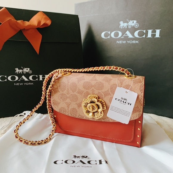 Coach Handbags - Coach Parker 18 In Signature Canvas With Rivets